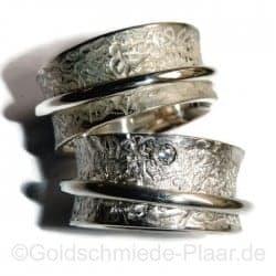 Rollringe aus Silber mit Brillant